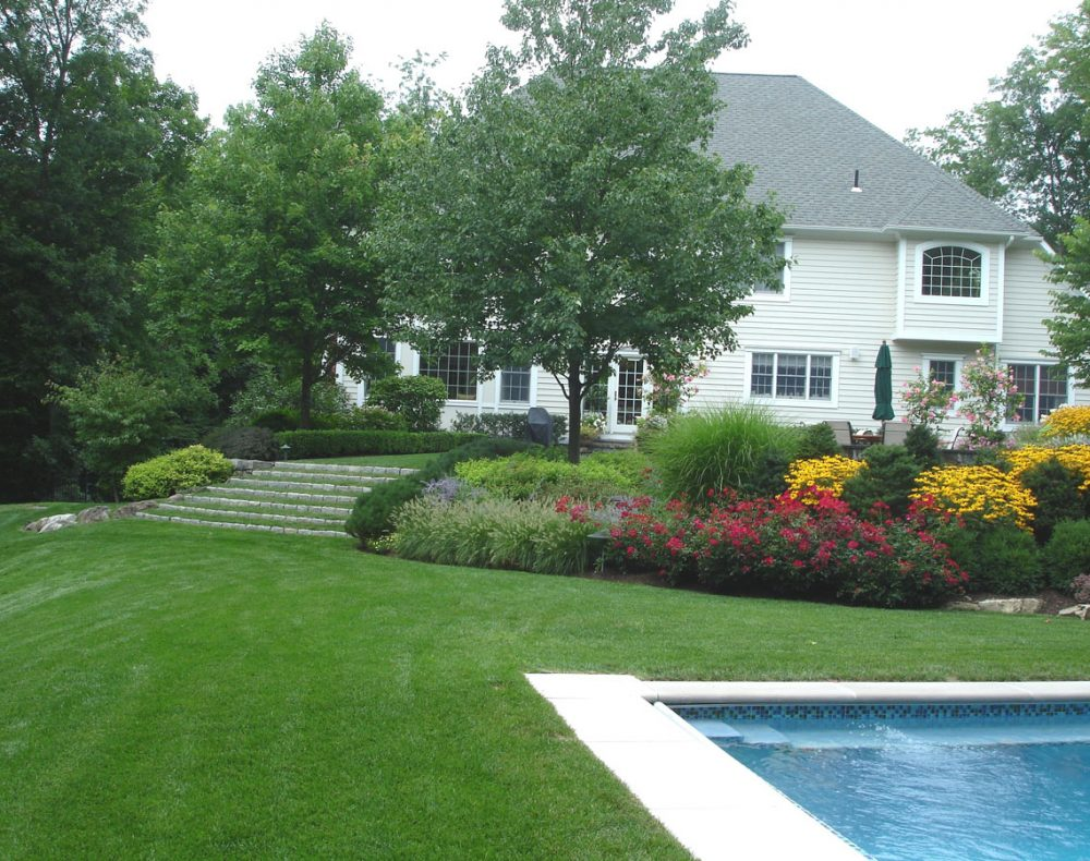 Fairfield landscape design house and pool with lawn