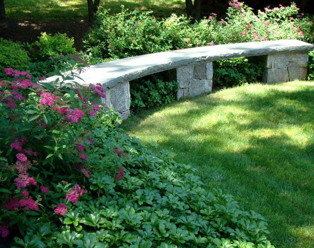 Westchester landscape and pool design stone bench