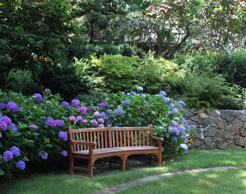 Westchester landscape and pool design wood bench