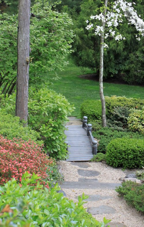 Walkway path with wood bridge - designed by Johnsen Landscapes