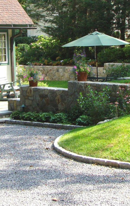 Arts & Crafts home garden plantings and gravel surface