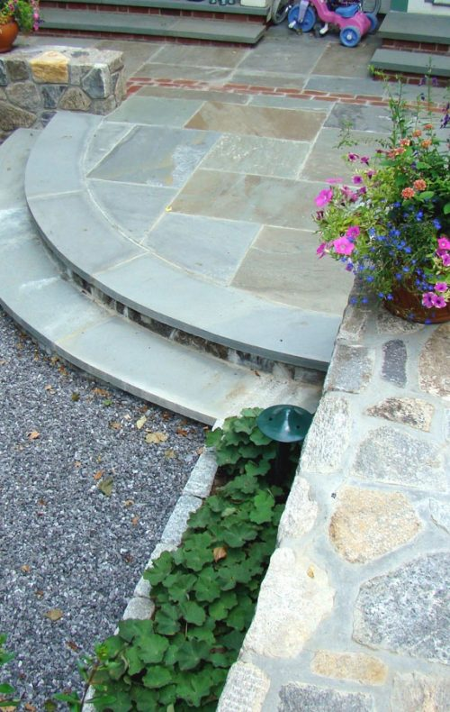 Arts & Crafts home garden stone steps and patio