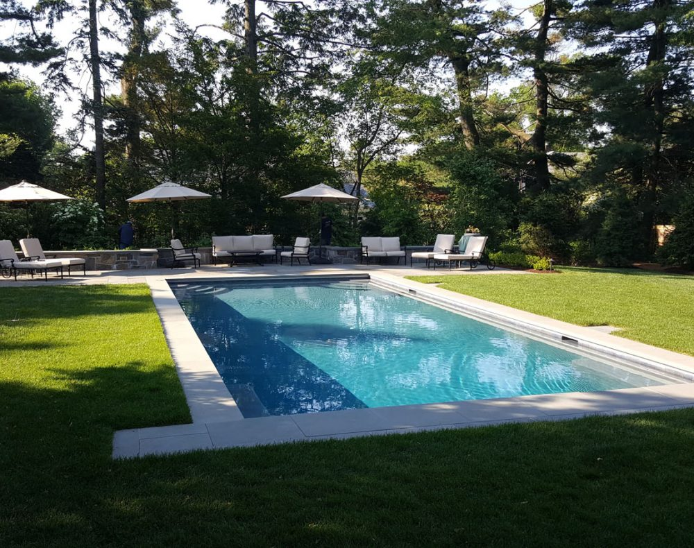 Salt water pool with lawn in Bronxville, New York