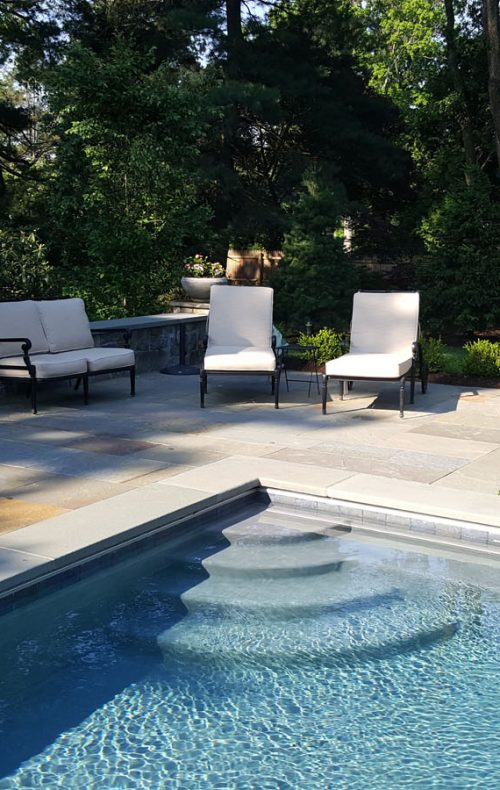 Pool deck design and landscape by Johnsen